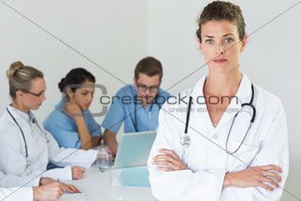 Portrait of confident professional doctor