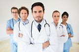Medical team standing arms crossed