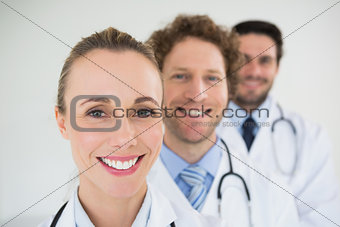 Smiling doctors in a row