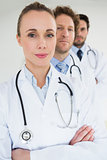 Confident doctors standing in a row