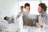 Doctors examining Xray in hospital