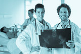 Doctors examining Xray
