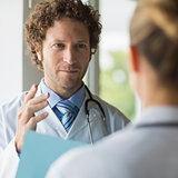 Doctor discussing with female colleague