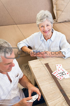 Portrait of happy woman playing card
