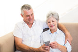 Senior couple using mobile phone