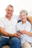 Senior couple with with mobile phone