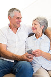 Loving couple holding mobile phone