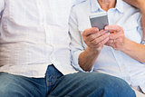 Senior woman text messaging on mobile phone