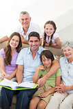 Happy multigeneration family with book