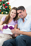 Loving couple holding Christmas present