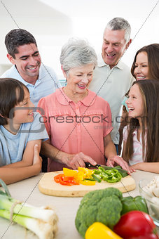Family preparing food at counter