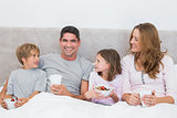 Man with family having breakfast