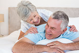 Senior couple lying in bed