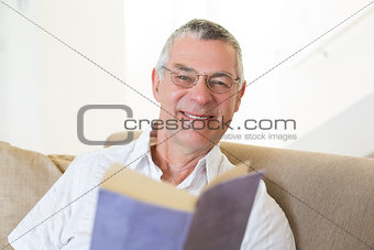 Handsome senior man with book