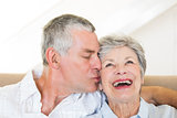 Senior man kissing happy wife