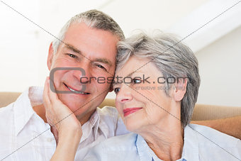 Senior woman touching husband