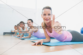Fit class gesturing thumbs up at fitness studio