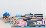 Sporty people with exercising rings in fitness studio