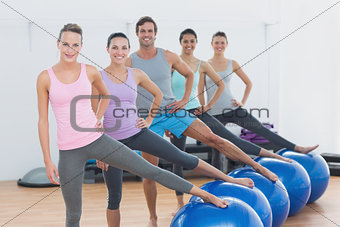 Fitness class with exercise balls at fitness studio