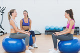 Sporty young women sitting on exercise balls