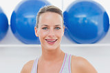 Closeup portrait of woman at fitness studio