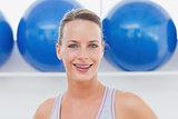 Closeup portrait of woman at fitness studio