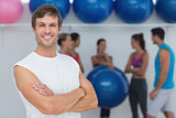 Man with friends in background at fitness studio