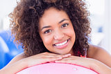 Portrait of a fit smiling young woman with fitness ball