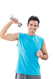 Portrait of a smiling man exercising with dumbbell