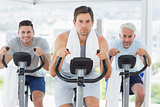 Man with friends on exercise bikes