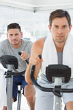 Determined man using exercise bike