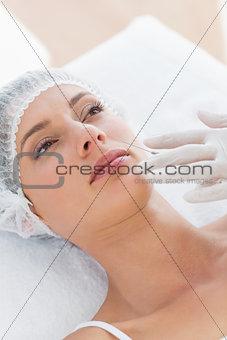 Beautiful woman recieving botox injection