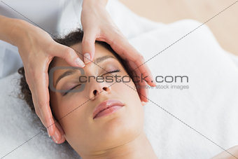Beautiful woman having head massage