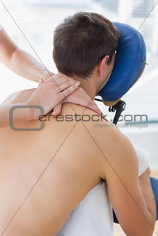 Man being massaged by therapist