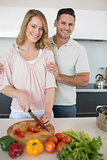 Couple preparing food together at kitchen counter