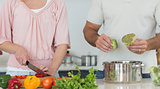 Midsection of couple preparing food together