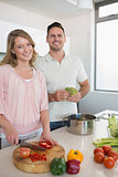 Couple cooking vegetables in kitchen