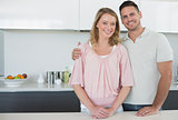 Couple standing at kitchen counter