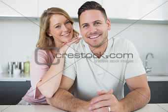 Loving couple at kitchen counter