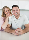 Smiling young couple at kitchen counter