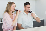 Couple drinking red wine at table