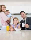 Family at breakfast table in house