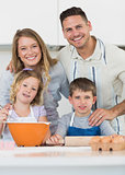 Family baking cookies at kitchen counter