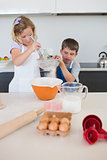 Children baking cookies in kitchen