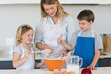 Children and mother baking cookies