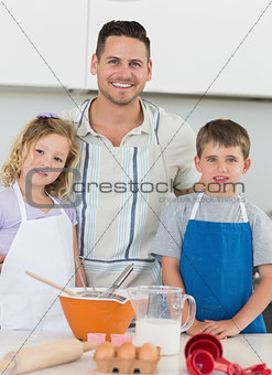 Portrait of family baking cookies