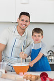 Father and son baking cookies together