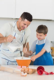 Father baking cookies with son