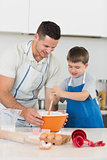 Father and son baking cookies