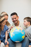 Family eploring globe